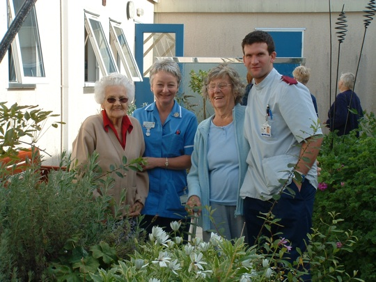 Patients and staff in the garden