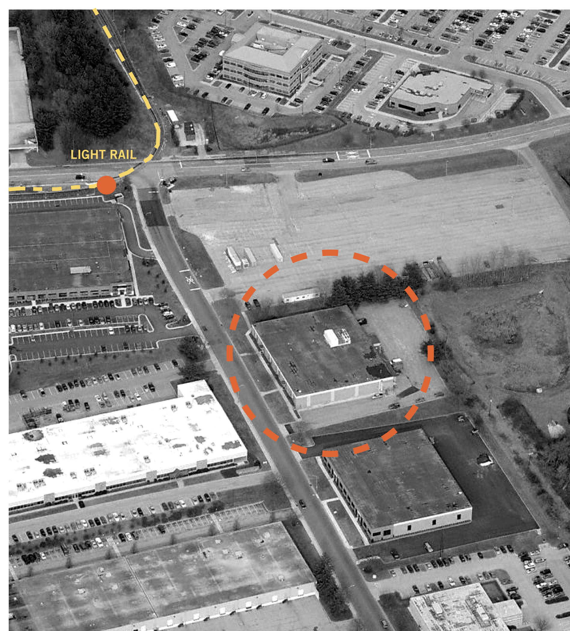 Aerial image of the original building including nearby light rail