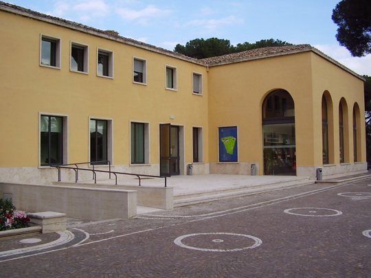 Travertine terrace with bookstore in building behind