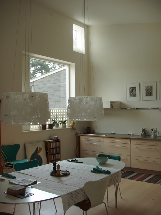 Kitchen view with a window and a table