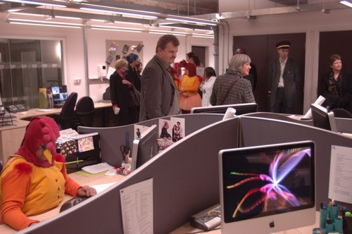 Staff members in the main office, some in chicken costumes