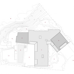 Site plan of house, show the topography of the sloping property