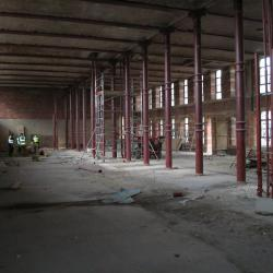 Gutted interior of building before renovation