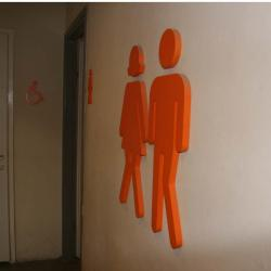 Orange male female and excessible symbols that protrude from white wall