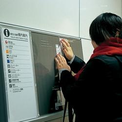 Women using her hands to read a tactile map